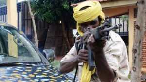 Now part of the national army, a Seleka terrorist poses for the camera.