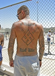 Aryan Brotherhood leader sporting pro-Nazi tattoos.