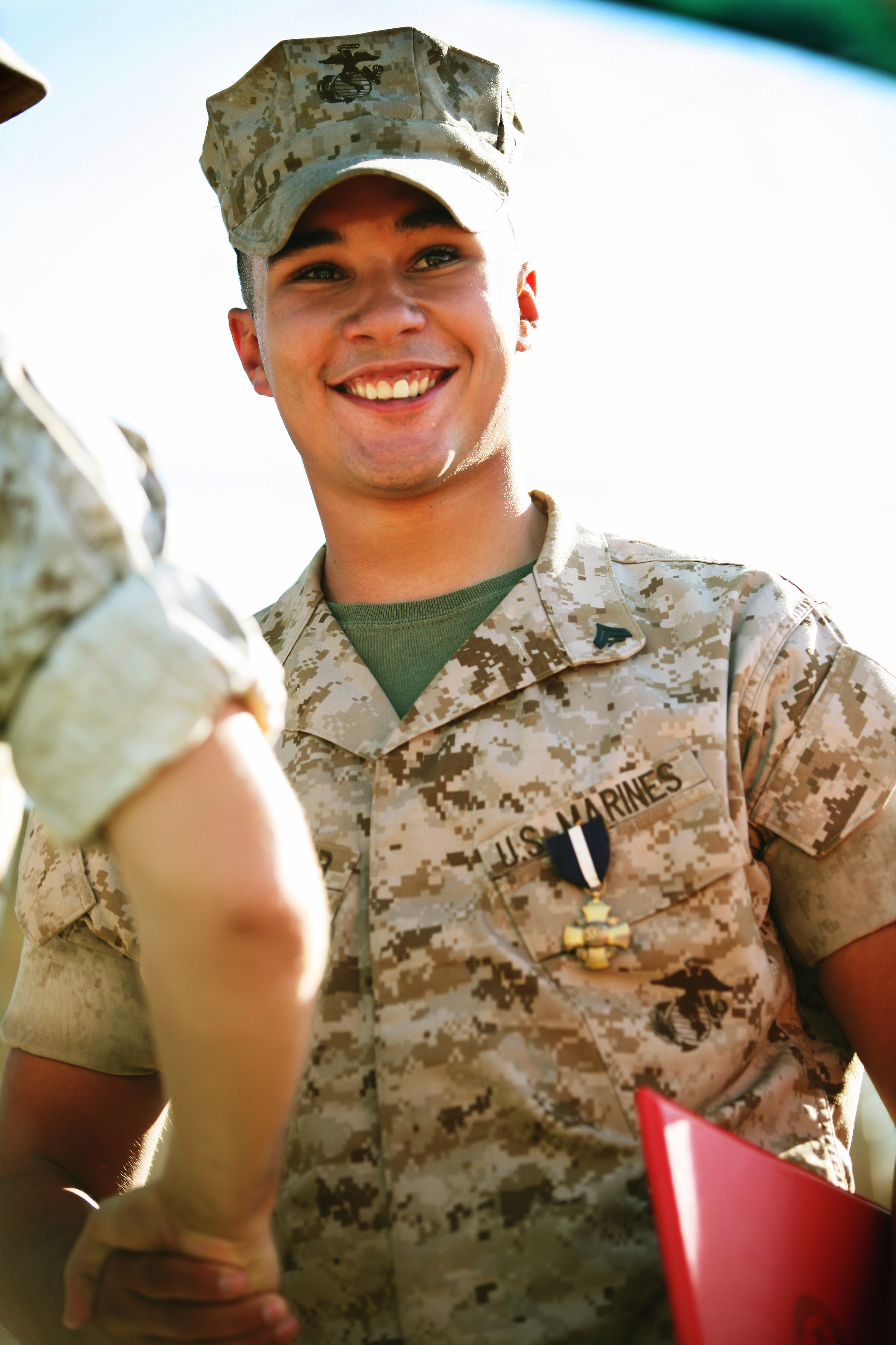 Cpl. Richard S. Weinmaster, a Squad Automatic Weapon gunner with the 7th Marine Regiment smiles as he is awarded awarded the Navy Cross for personal heroism in combat.