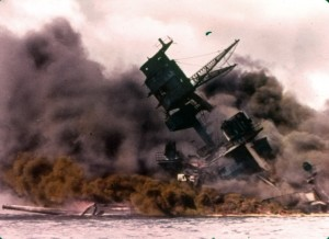 USS Arizona ablaze with hundreds of sailors still trapped below decks. The stricken ship became their tomb.