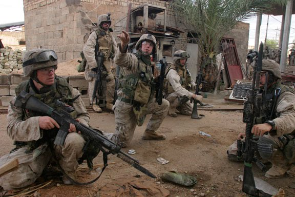 Marines fix bayonets as they prepare to enter into the fray in Fallujah, Iraq.