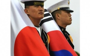 A Japanese sailor and ROK Marine.