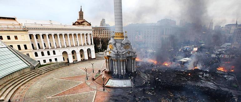 Composite photo of Kiev before the uprising and now.