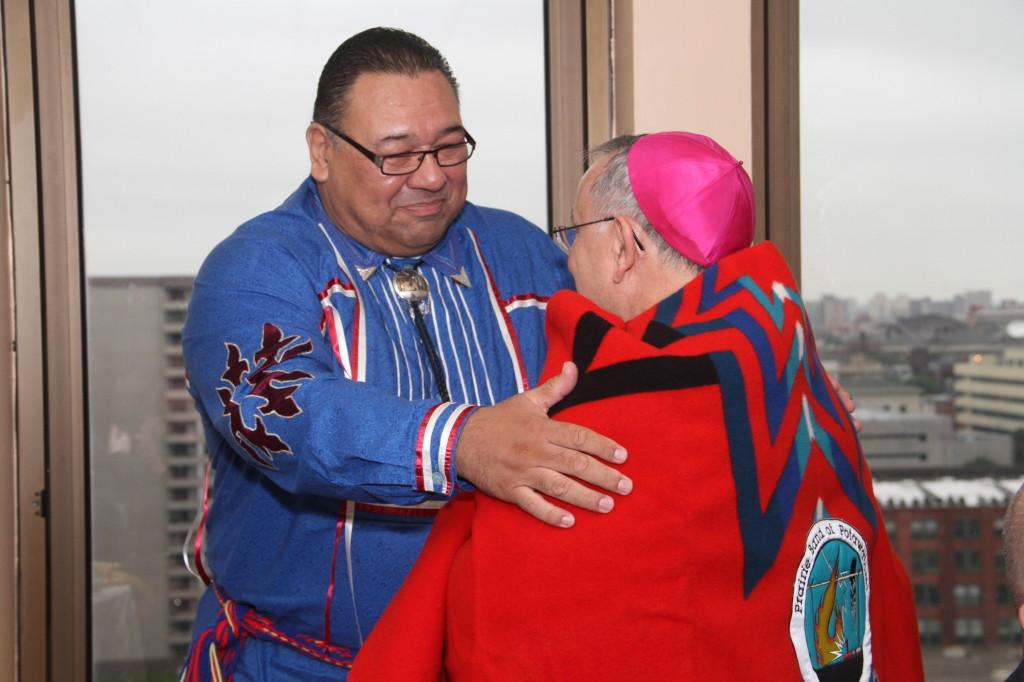 Tribal Chairman Steve Ortiz presents a Pendleton blanket with the tribal logo to Archbishop Chaput  prior to his installation as Philadelphia's Archbishop.