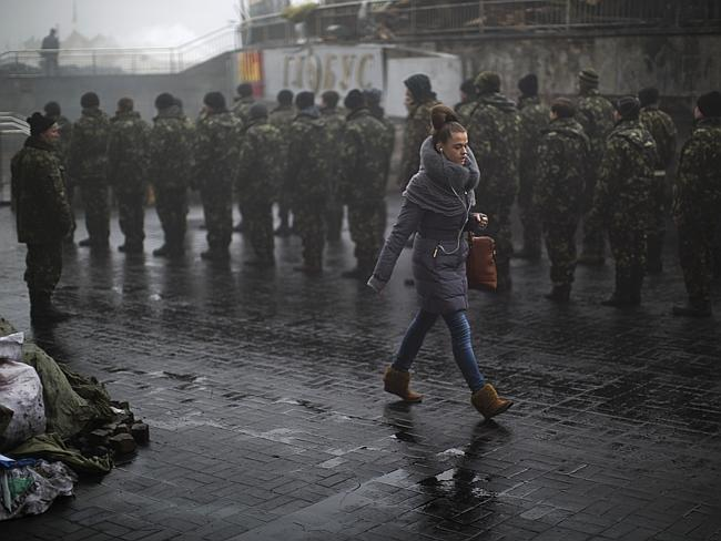 Kievan passes by new recruits for Ukrainian Army mustering in Independence Square.