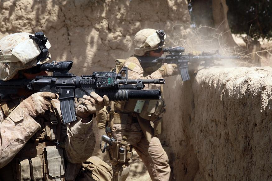 U.S. Marine Corps Sgt. Ryan Pettit (left) and Cpl. Matthew Miller with 2nd Battalion, 8th Marine Regiment open fire on the enemy during an operation in the Helmand province of Afghanistan on July 3, 2009. Flickr.com photo sharing (Google Image labeled authorized for reuse).