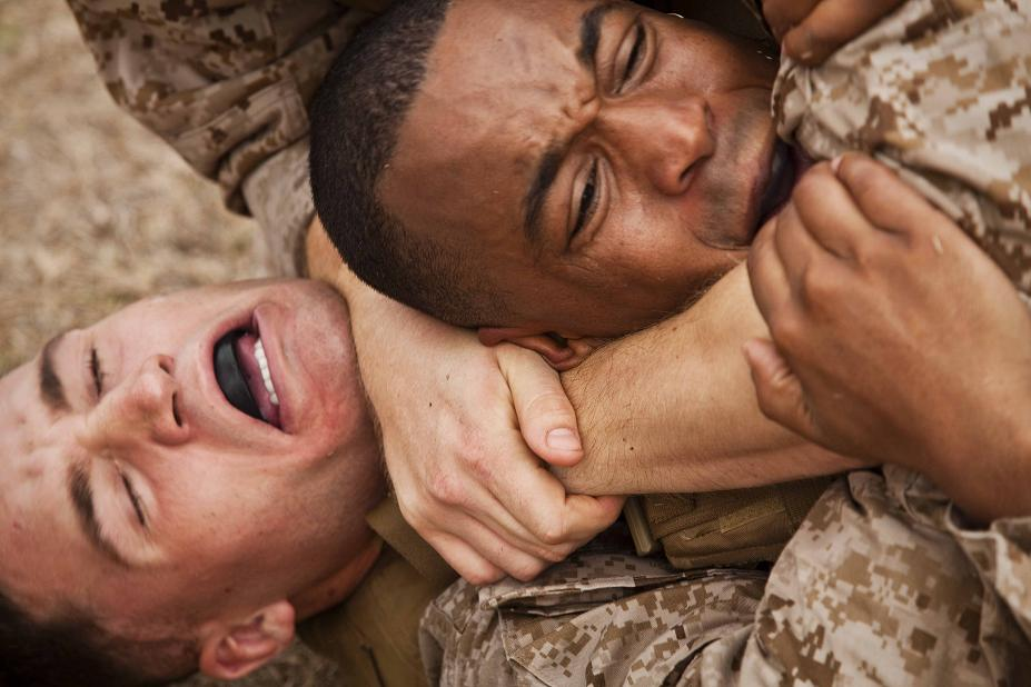 Cpl. Derrick Horne and Sgt. Jonathan Lewis, students with Martial Arts Instructor Course 7-10, grapple during combat conditioning drills at Landing Zone 216 on Marine Corps Base Hawaii, Sept. 15, 2010.