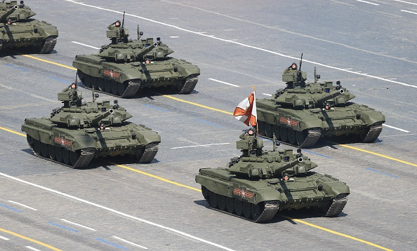 MOSCOW, RUSSIA - MAY 9:  In this handout image supplied by Host photo agency / RIA Novosti, T-90A main battle tanks during the military parade to mark the 70th anniversary of Victory in the 1941-1945 Great Patriotic War, May 9, 2015 in Moscow, Russia. The Victory Day parade commemorates the end of World War II in Europe. (Photo by Host photo agency / RIA Novosti via Getty Images)