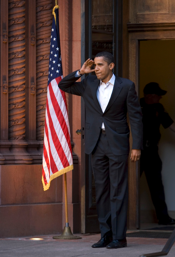 Barack Obama stops to salute to the crowd before the rally on the UO campus.