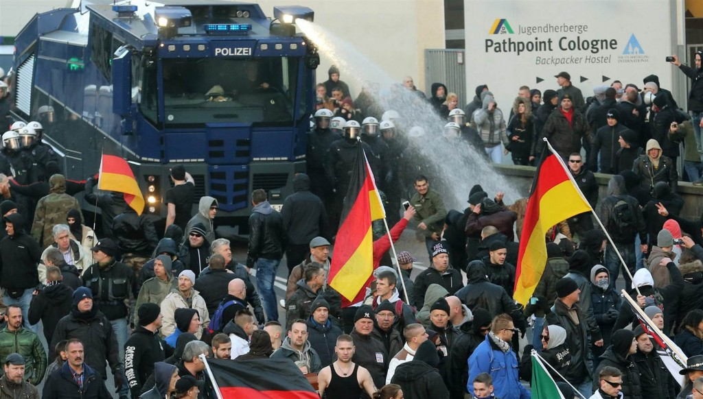 German police open up with a water cannon against pro-German marchers.