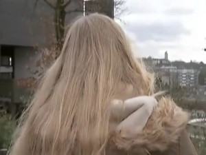Cologne rape victim turns her back to the news cameras.