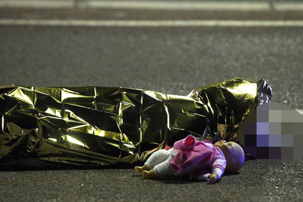 Dead little girl with her doll baby - Nice, France.