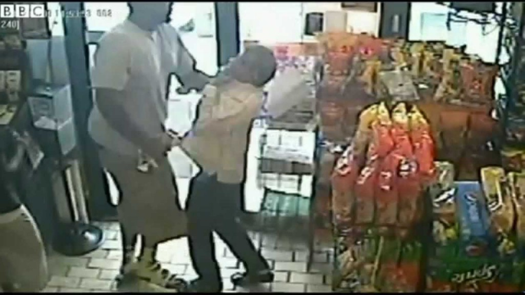 Michael Brown caught on film committing a strong arm robbery.