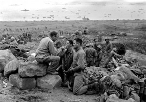 Marines receiving Holy Communion during a lull in the Battle of Iwo Jima. (Photo: Wikipedia)
