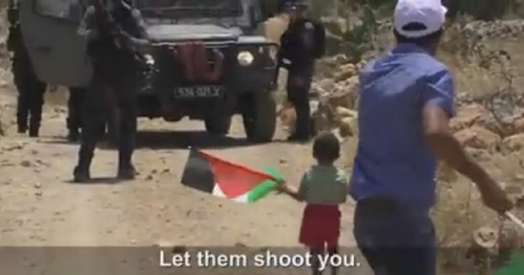 Arab father attempts to instigate his own child to be shot.