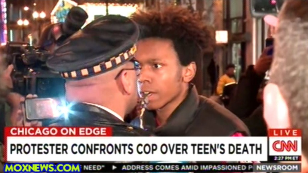BLM agitator attempts to provoke a Chicago cop. (Photo: Screen capture, Youtube).