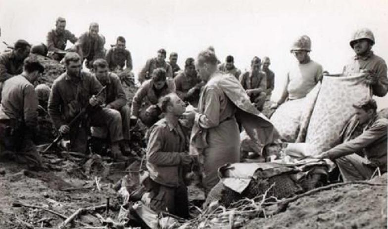 Spiritual Fitness in action - Holy Communion atop Mt. Suribachi during the Battle of Iwo Jima. (Wikimedia)