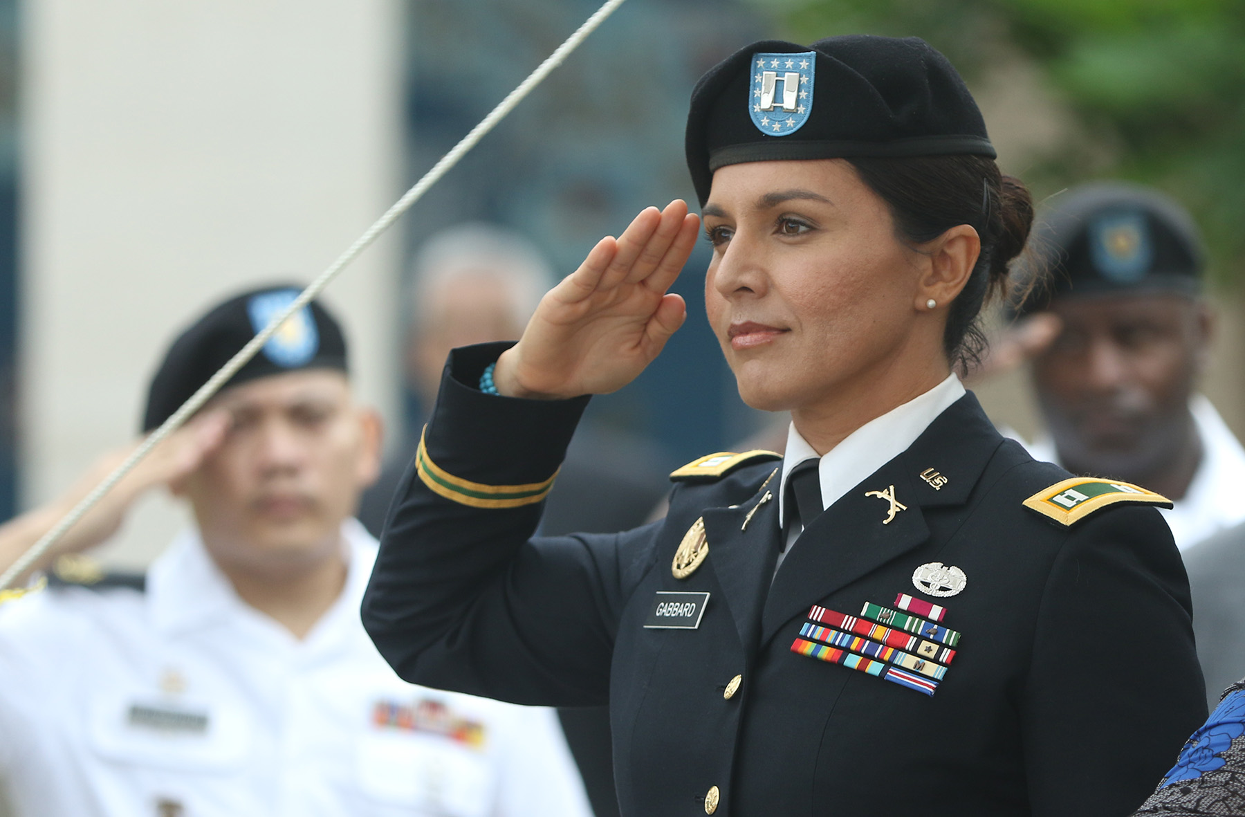 Congresswoman Tulsi Gabbard salutes during the singing of the National Anthem during promotion ceremonies at the National Memorial of the Pacific. Punchbowl Cemetery. 12 oct 2015. photograph by Cory Lum/Civil Beat