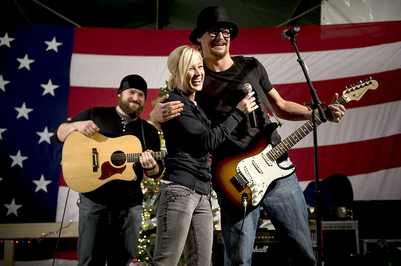 Grammy award-winning musician Kid Rock, American Idol contestant and country musician Kellie Pickler, and musician Zack Brown entertain troops stationed at Kandahar, Afghanistan, Dec. 17, during the 2008 USO Holiday Tour. (Wikimedia-Commons)