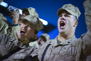 U.S. Marine Corps Cpl. Chantel Saville (left) and Sgt. Jonathan Oaks cheer at the introduction of Grammy award-winning musician Kid Rock and Zac Brown during the 2008 USO Holiday Tour stop at Al Asad Air Base, Iraq, Dec, 19, 2008. (Wikimedia-Commons)