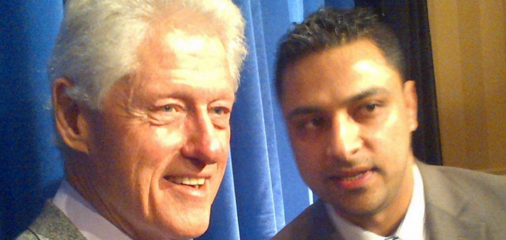 Imran Awan with Bill Clinton. (Facebook)